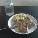 Pork chops, scrambled eggs, and water