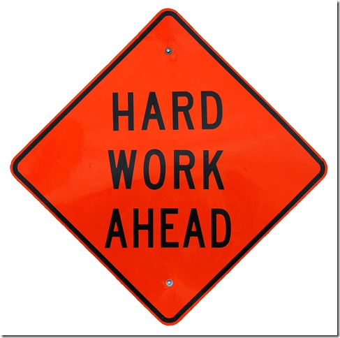 A sign that says Hard Work Ahead