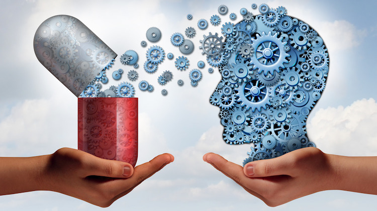 A pill connecting gears to a human brain made of gears to represent getting smarter with modafinil