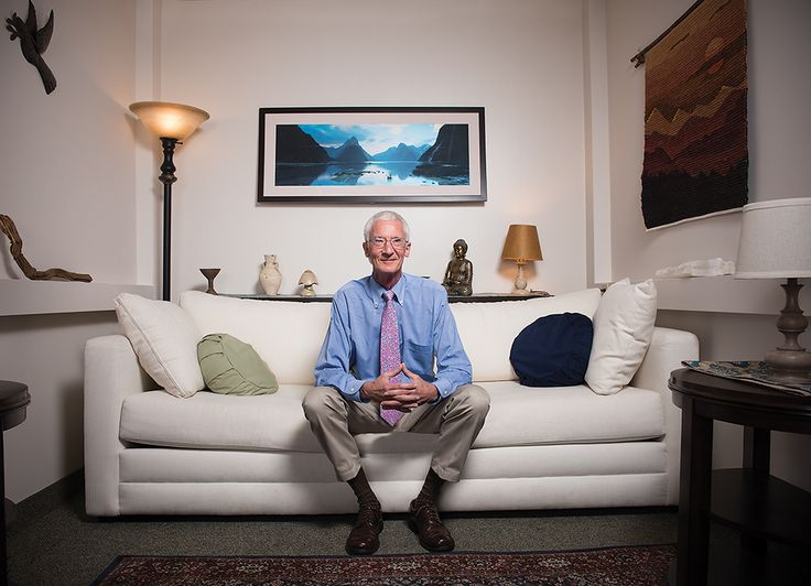 Dr. Roland R. Griffiths sitting on the couch in a psychedelic therapy research session room at Johns Hopkins University